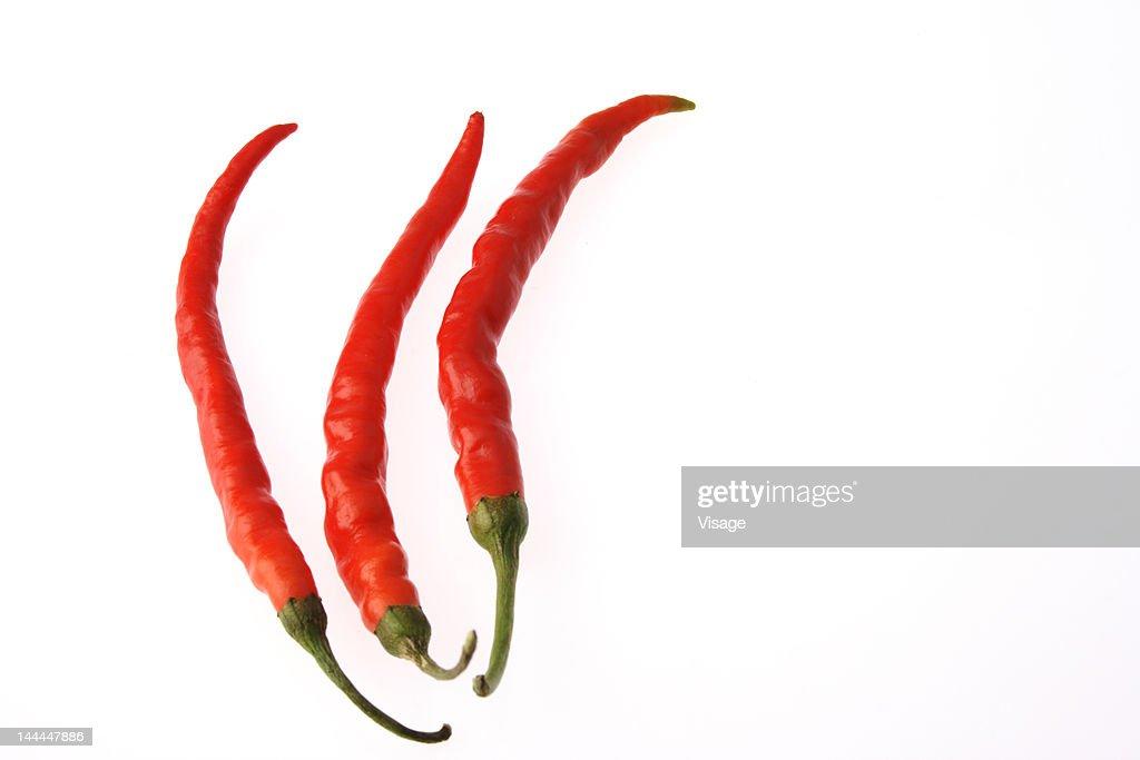Three red chilies : Stock Photo
