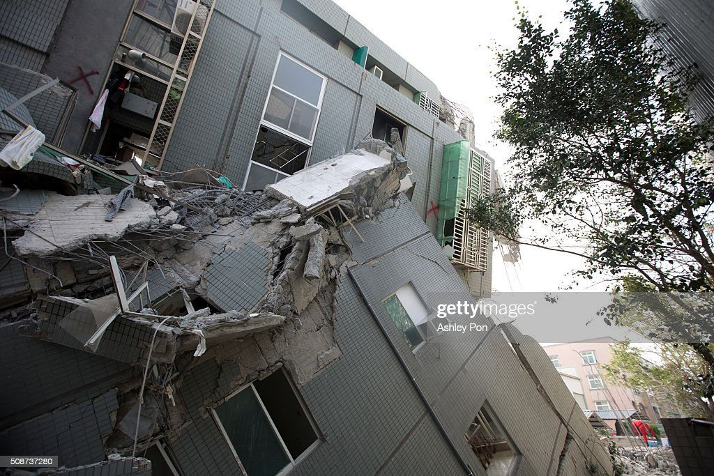 Three residential buildings collaped after hit by earthquake early this morning on February 6, 2016 in Tainan, Taiwan. A magnitude 6.4 earthquake hit southern Taiwan early Saturday, toppling several buildings and killing at least five people in Tainan, according to local news reports.