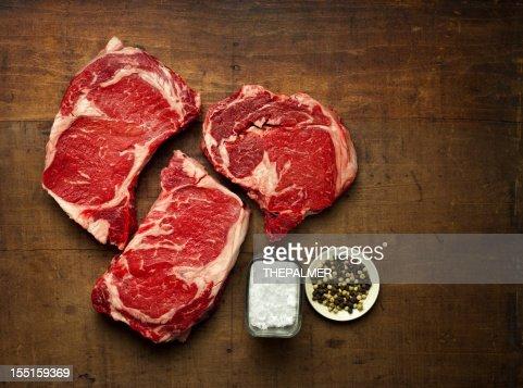 three rib-eye steaks