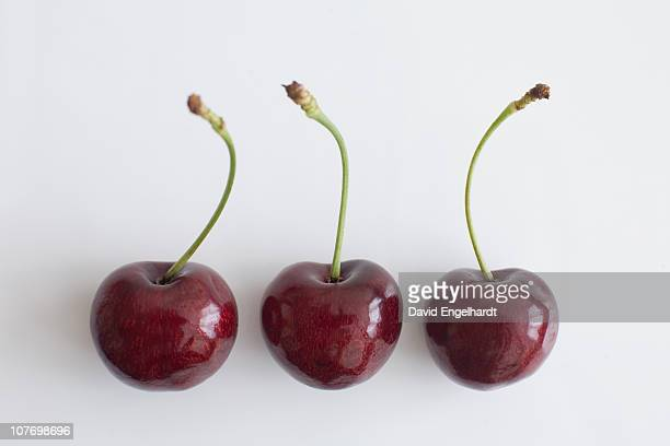 Three ripe cherries