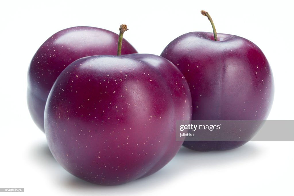 Three ripe plums isolated on a white background