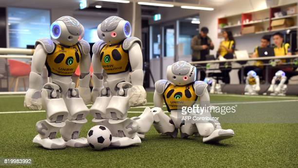 Three robots battle it out for the soccer ball in Sydney on July 21 as Australias fivetime world champions of robot soccer the University of New...