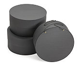 Three round dark grey hat boxes with clipping path
