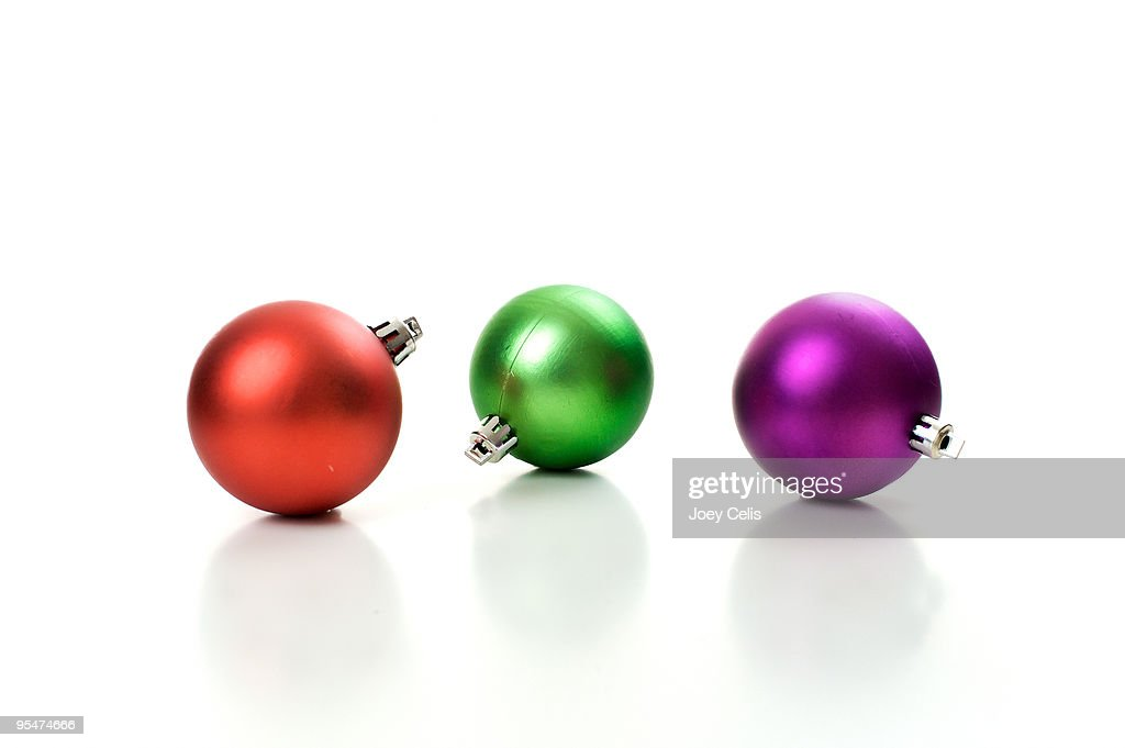 Three round holiday ornaments