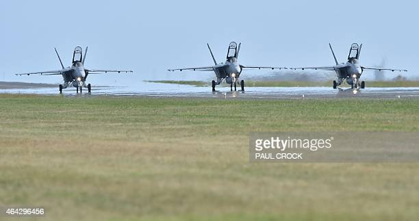 Three Royal Australian Air Force F18 Hornets taxi on the runway during the Australian International Airshow at the Avalon Airfield near Lara...