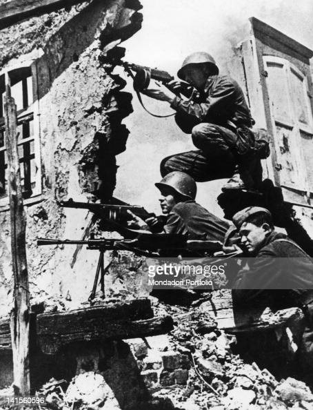Three Russian soldiers lying in ambush amid the ruins of a building in Stalingrad Stalingrad October 1942