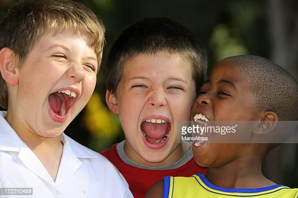 Three Schoolboys Shouting two