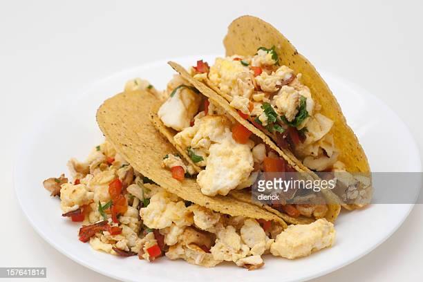 three scrambled egg tacos