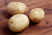 Three scrubbed new potatoes, close up