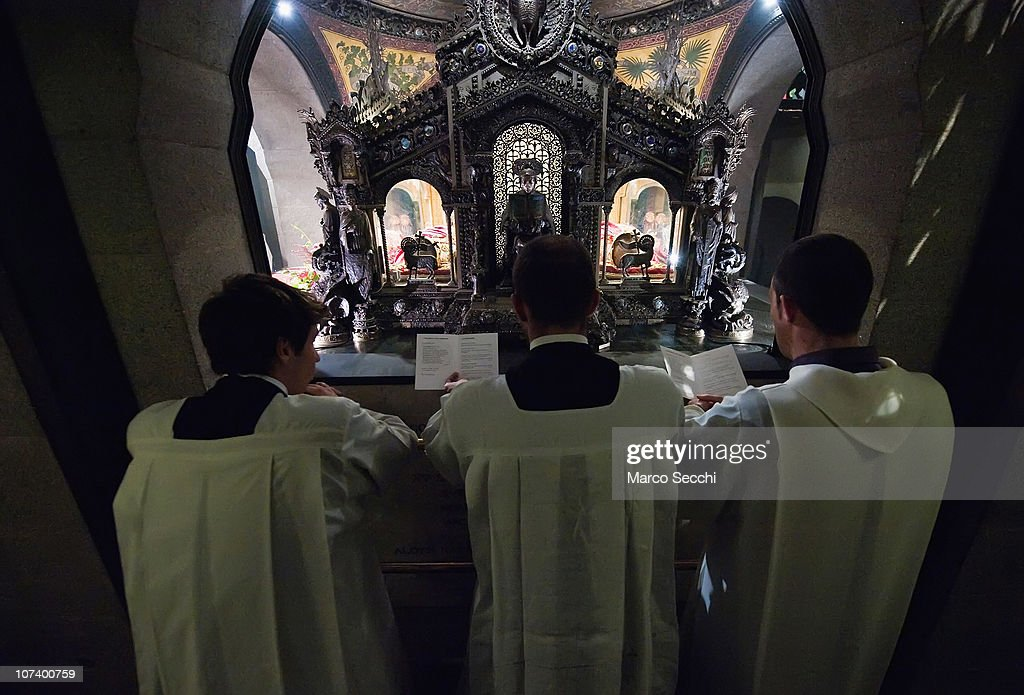 Three seminaries pray in front of the relics of Saint Ambrogio at Basilica of Sant'Ambrogio on December 7 2010 in Milan Italy The skeleton of Saint...