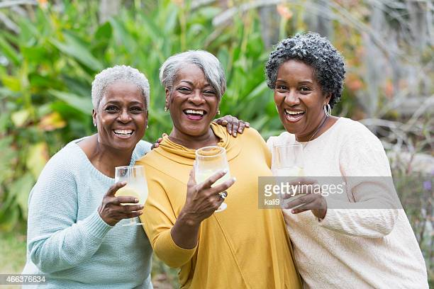 Three senior African American woman with drinks