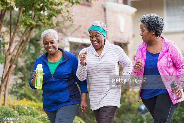 Three senior black women exercising together