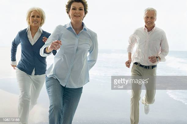 Three Seniors Running on Beach