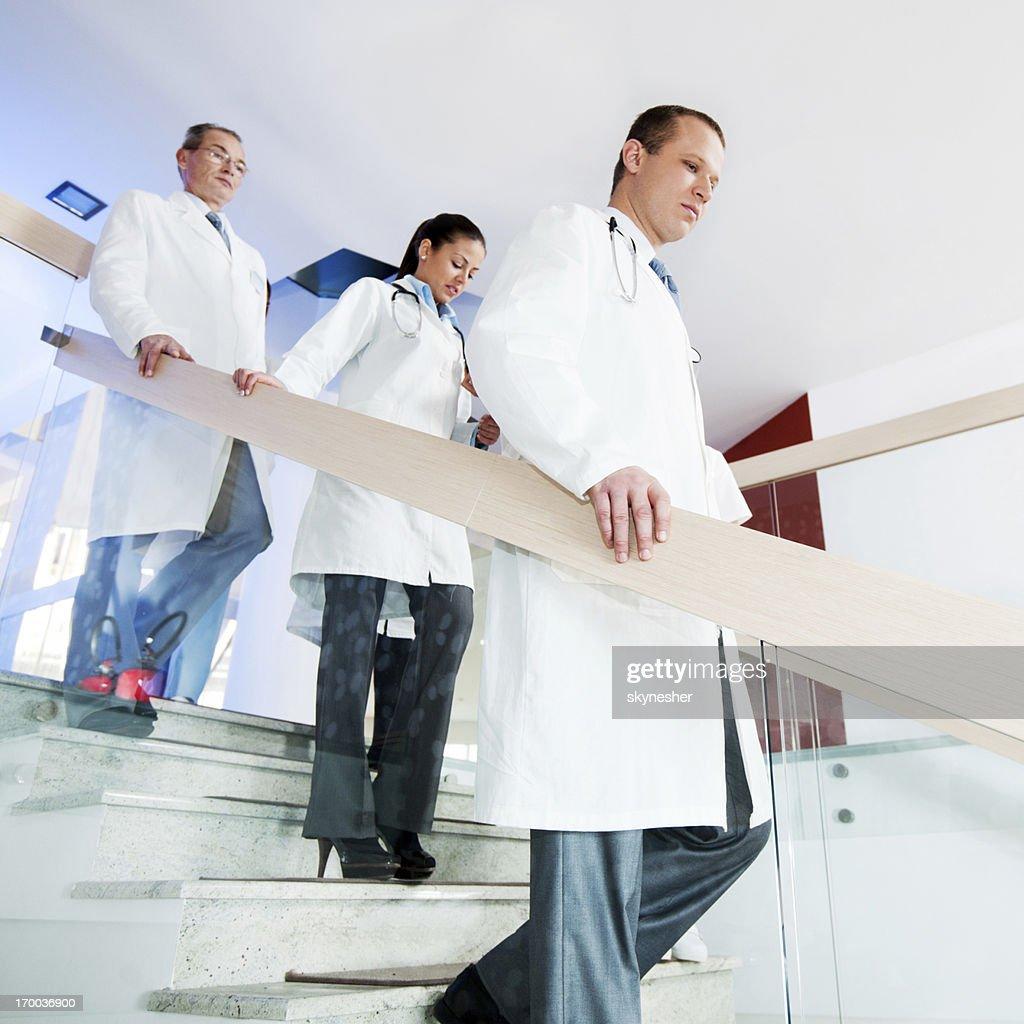 Three serious doctors. : Stock Photo