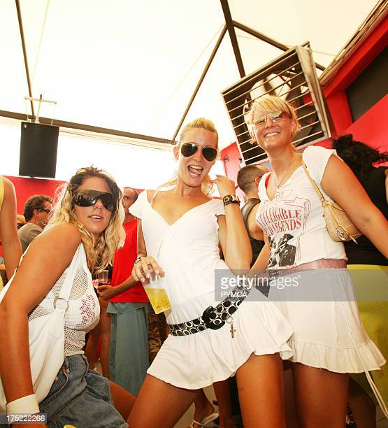 Three sexy girls dancing Circo Loco at DC10 Ibiza 2005