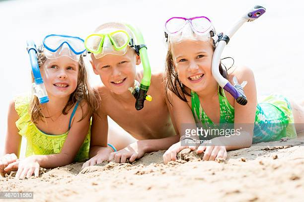 Three Siblings Snorkeling at the Beach