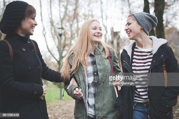 Three sisters chatting in park