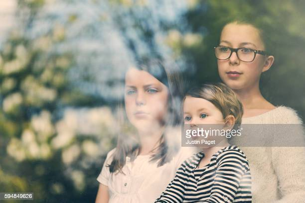 Three Sisters in Window