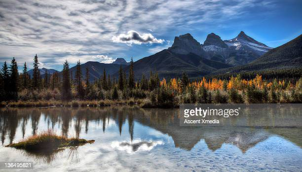 Three sisters Mountains refelected in a pond.