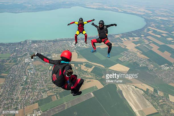 Three skydivers freeflying in formation, Siofok, Somogy, Hungary