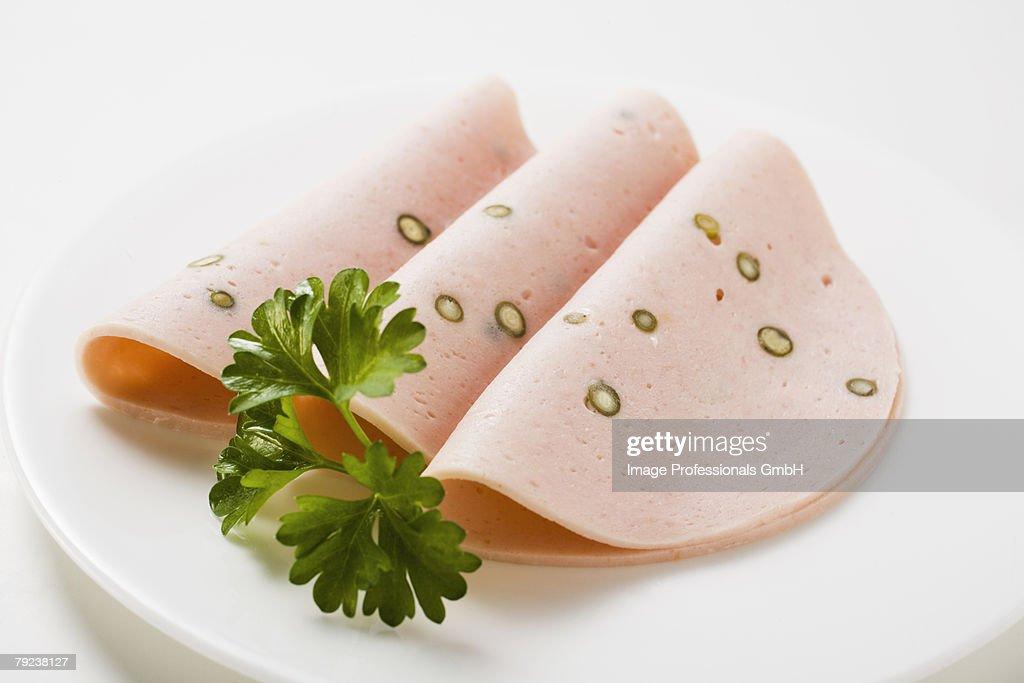Three slices of Pfefferwurst (pepper sausage)