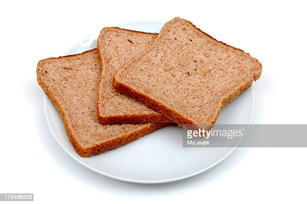 Three Slices Of Whole meal Bread On A Ceramic Plate