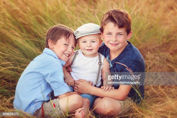 Three smiling brothers
