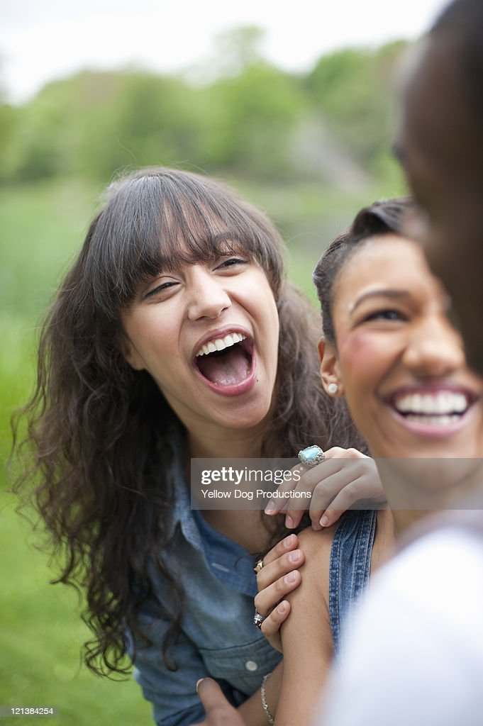 Three Smiling College Students Outdoors : Stock Photo