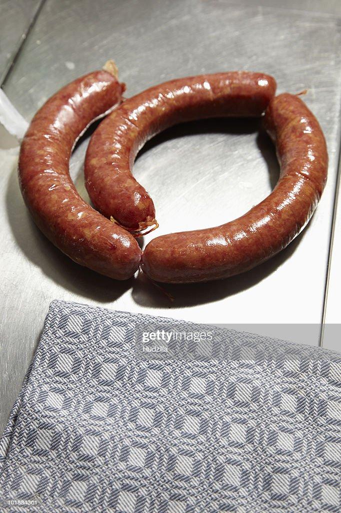 Three smoked sausages : Stock Photo