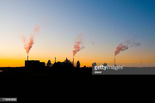 Three smoking chimneys