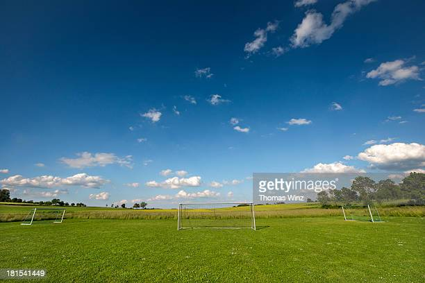 Three Soccer goals in a field in spring