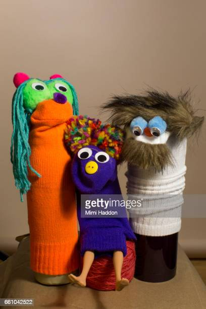 Three Sock Puppets posing for a Family Portrait
