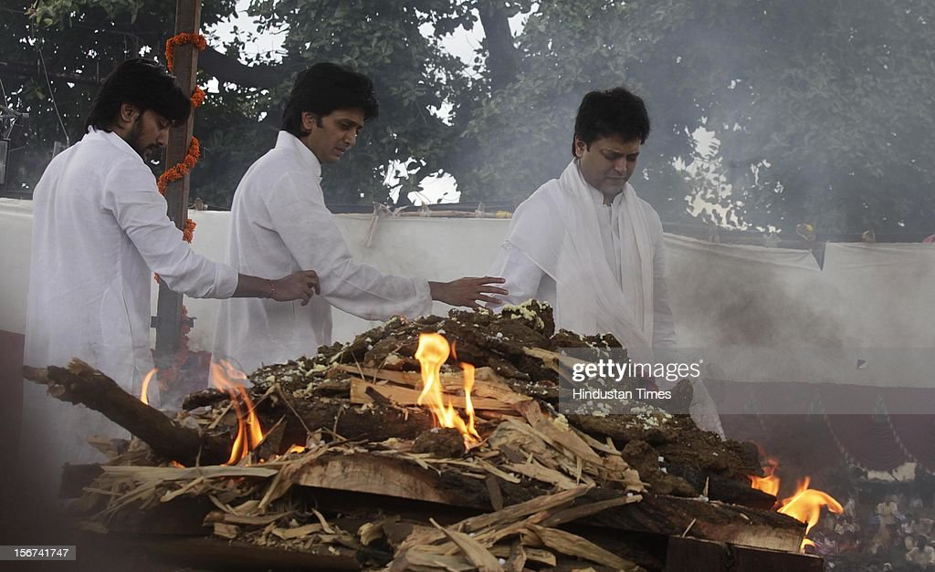 'MUMBAI, INDIA - AUGUST 15: Three sons of Late Vilasrao Deshmukh fulfill their last duties towards their father at the crematorium (Ex Chief Minister of Maharashtra and Union Minister for Science and Technology) at his native village, Babhalgaon, on August 15, 2012 in Latur District, India. (Photo by Kalpak Pathak/Hindustan Times via Getty Images) '