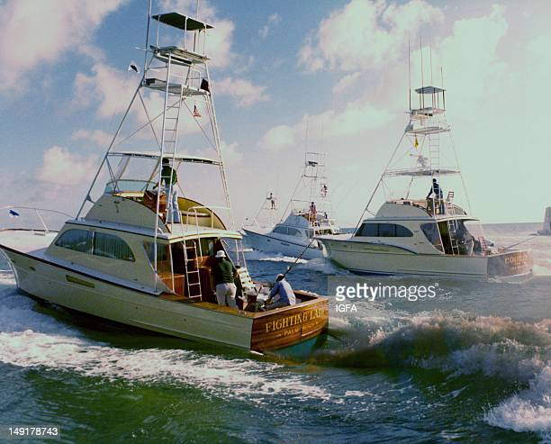 Three sportfishing boats among them the Fighting Lady of Palm Beach Florida head out to open water