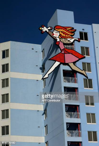 A three story sculpture graces the side of an affordable housing building by Brazilian artist Romero Britto in Miami Florida on July 15 2017 The art...
