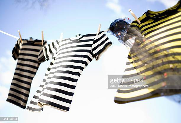 Three striped t-shirts hanging out to dry Sweden.