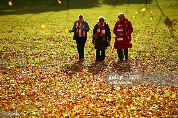 Three Sunderland fans make their way to the stadium prior to kick off during the Premier League match between AFC Bournemouth and Sunderland at...