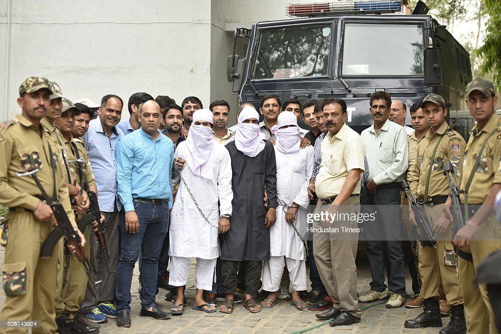 Three suspected terrorists (with covered face) in the custody of Delhi Police Special Cell at Lodhi Special Cell on May 4, 2016 in New Delhi, India. The special cell of Delhi Police has detained 12 people suspected to be linked with a terror outfit planning an attack in the city and recovered explosives from their possession after a series of overnight raids in the national capital and neighbouring states. The arrested people are suspected to be linked with a terror outfit Jaish-e-Mohammad.