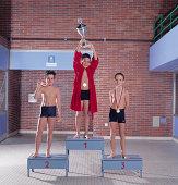 Three Swimmers on Podium