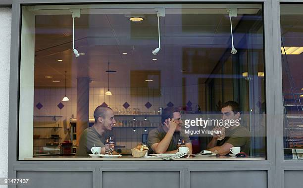 Three Swiss soldiers eat breakfast in a backery on October 6 2009 in Pfaeffikon Switzerland Due to lower taxes and less regulation the small Swiss...