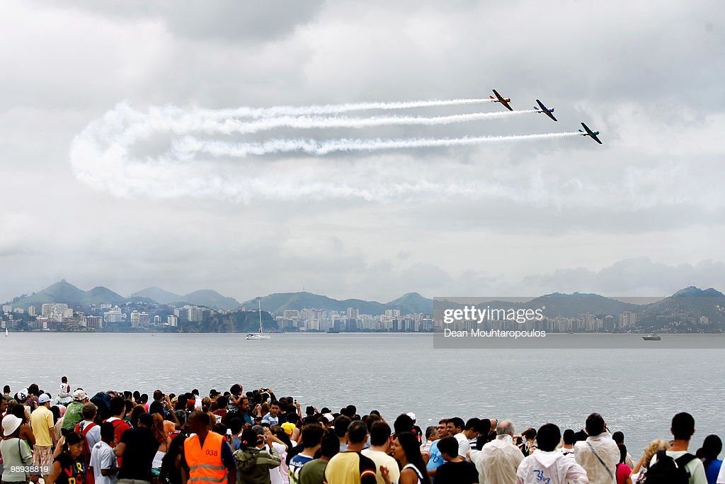 Three T6 Texan, Skywriting 'Oi' perform during the Red Bull Air Race Day on May 9, 2010 in Rio de Janeiro, Brazil.