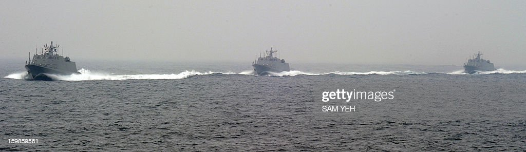 Three Taiwan made Kuang-Hua Six missile boat patrol the sea near the Tsoying naval base in southern Kaohsiung city on January 22, 2013. Taiwan's frigates, missile boats, rescue helicopter and submarines are taking part in an annual training before the coming lunar new year. AFP PHOTO / Sam Yeh