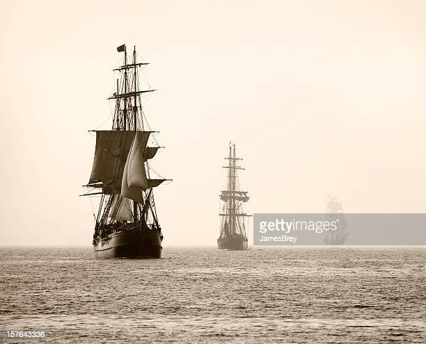 Three Tall Ships Sail in Light Fog