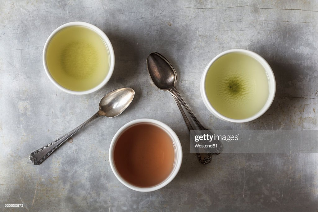 Three tea bowls of Sencha, Hojicha, Genmaicha and three tea spoons