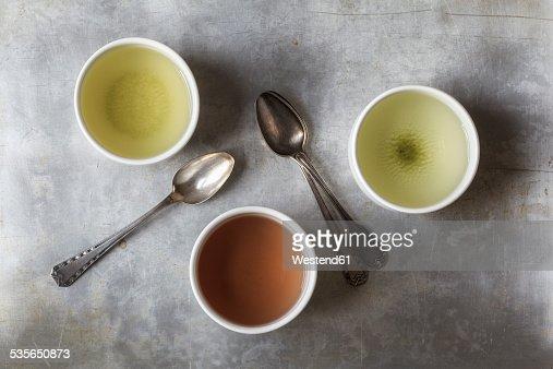 Three tea bowls of Sencha, Hojicha, Genmaicha and three tea spoons
