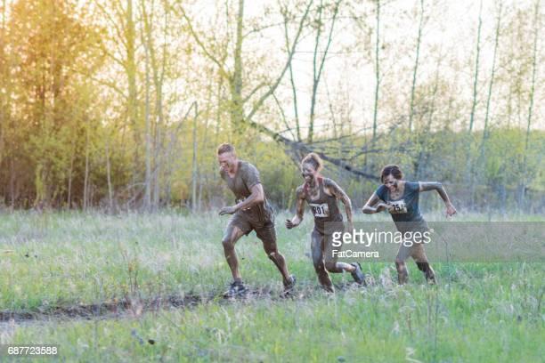 Three Teammates During Mud Run