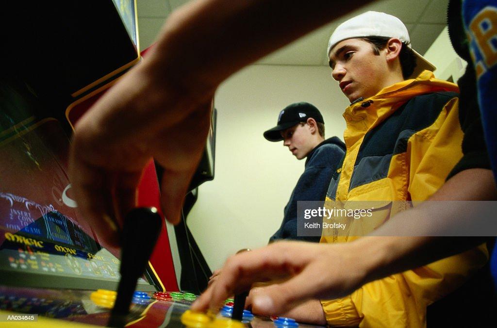 Three Teenage Boys Playing Video Games