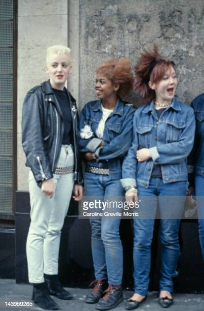 Three teenage girls wearing post punk fashions 1980