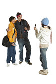 Three teenagers (13-16), girl photographing boys with camera phone