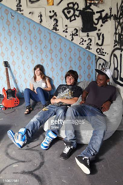 Three teens lounging in their den